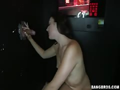 Gorgeous brunette blowing two dicks in the same time