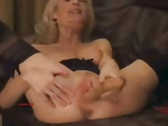 Skinny mature blonde fucks her hole with a hard sex toy