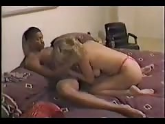 Hot blondy sucks on a dick of a hung chocolate male