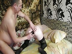 Elegant Russian blonde is being fucked by a dildo and her fat boyfriend